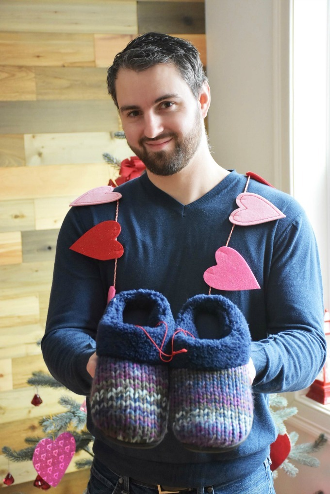 Man holding womans slippers1