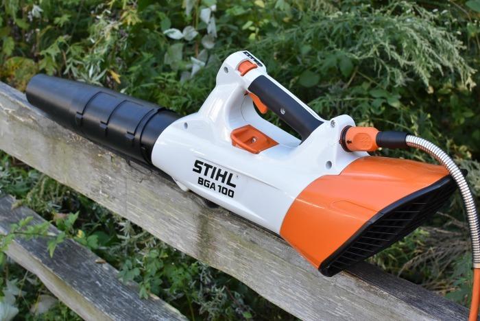Stihl Handheld Battery Blower sitting on fence rail.