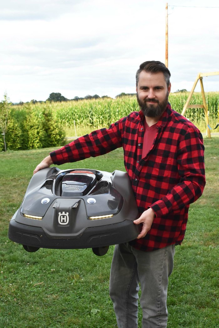 Man holding the Husqvarna Automower 450XH