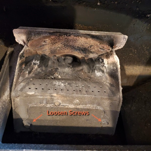 "igniter cover with a caption that says ""loosen screws"" and an arrow pointing to each of the 2 screws."