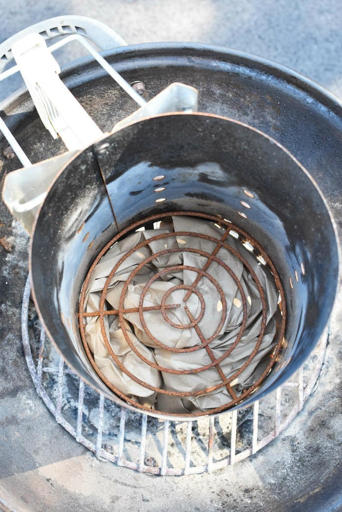 looking down into an empty charcoal chimney